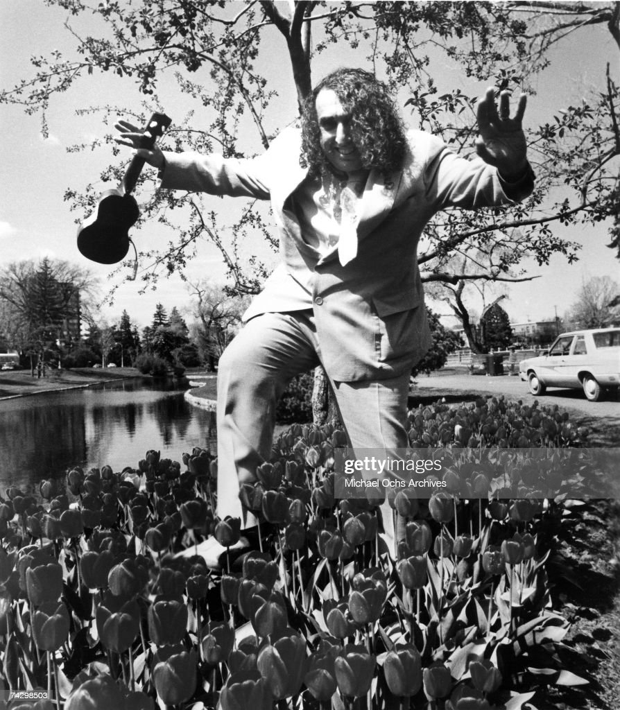 Singer and ukulele player Tiny Tim Tip-Toes Thru' The Tulips in a personal management publicity still circa 1975.