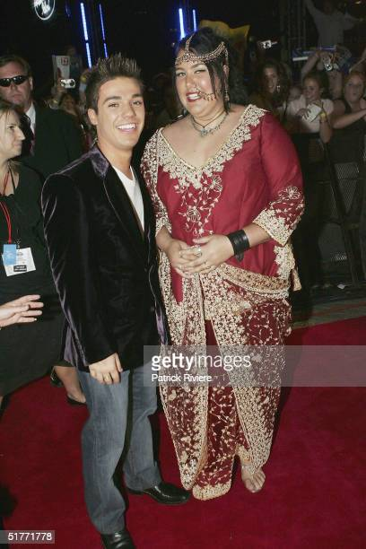 Singer and winner of the second Australian Idol Cassey Donovan and runner up Anthony Callea arrive at the Opera House November 21 2004 in Sydney...