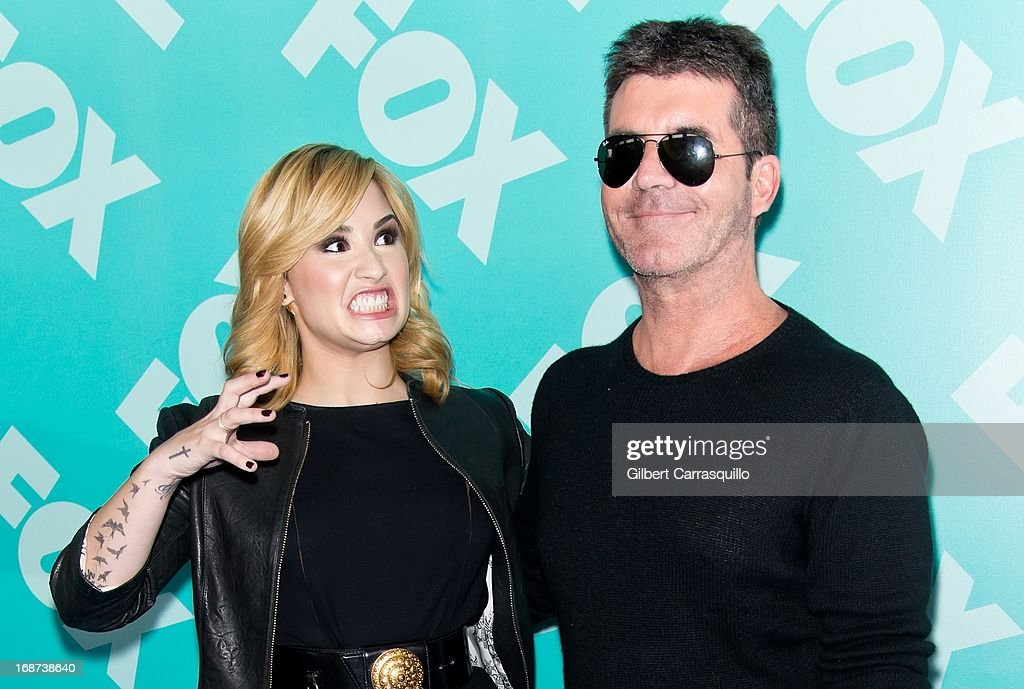 Singer and X Factor judge Demi Lovato and X Factor judge Simon Cowell attend the FOX 2103 Programming Presentation Post-Party at Wollman Rink - Central Park on May 13, 2013 in New York City.