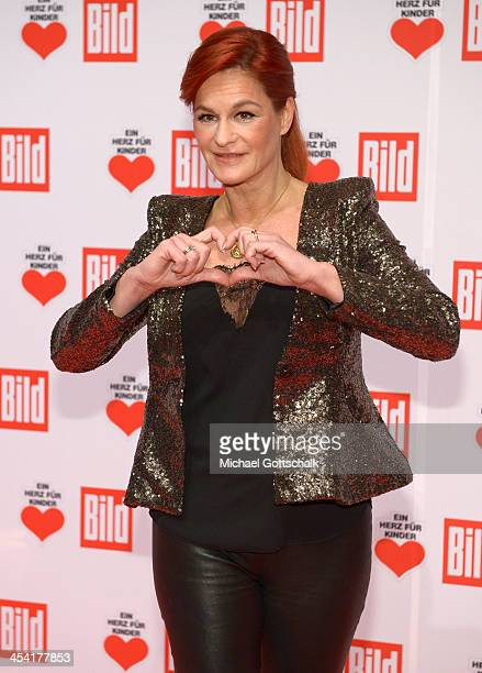 Singer Andrea Berg attends the Ein Herz Fuer Kinder Gala 2013 at Flughafen Tempelhof on December 7 2013 in Berlin Germany