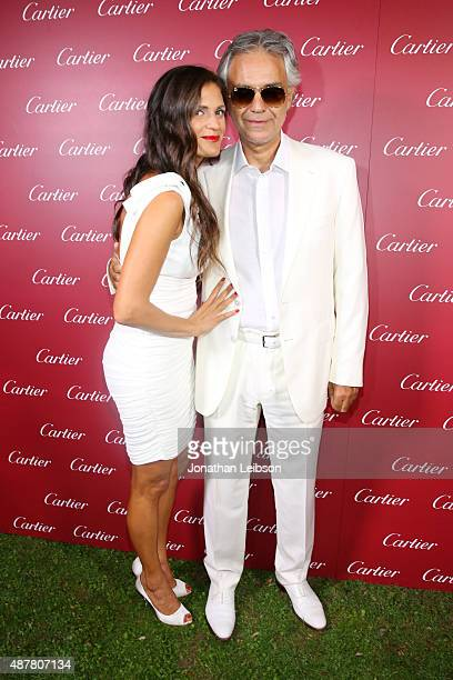 Singer Andrea Bocelli and his wife Veronica attend the white party dinner hosted by Andrea and Veronica Bocelli sponsored by Cartier during 2015...