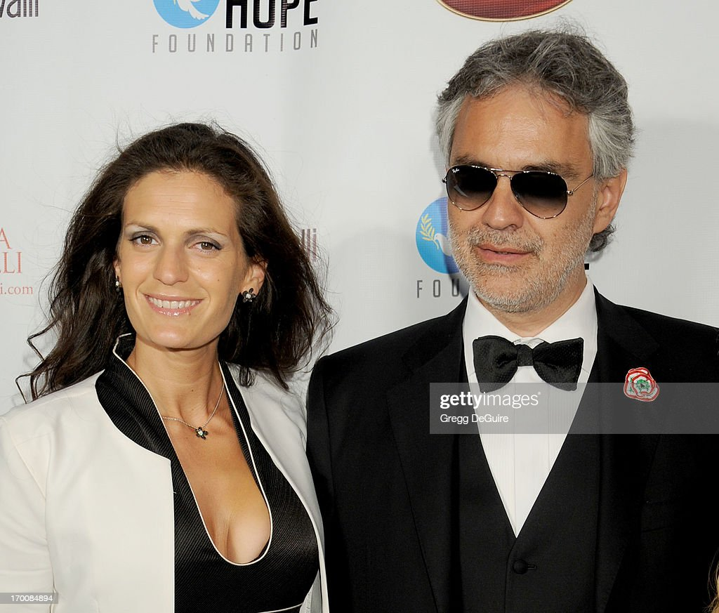 Singer <a gi-track='captionPersonalityLinkClicked' href=/galleries/search?phrase=Andrea+Bocelli&family=editorial&specificpeople=211558 ng-click='$event.stopPropagation()'>Andrea Bocelli</a> (R) and wife Veronica Bocelli arrive at the Celebration Of All Fathers Gala dinner at Paramount Studios on June 6, 2013 in Hollywood, California.