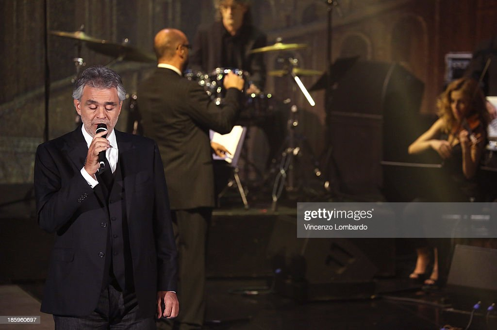 Singer <a gi-track='captionPersonalityLinkClicked' href=/galleries/search?phrase=Andrea+Bocelli&family=editorial&specificpeople=211558 ng-click='$event.stopPropagation()'>Andrea Bocelli</a> (L) performs on tv show 'Che Tempo Che Fa' on October 26, 2013 in Milan, Italy.