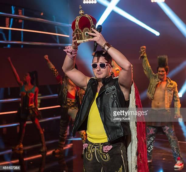 Singer Andreas Gabalier holding a crown performs during the TVShow 'Gabalier Die VolksRock'n'RollShow' on August 30 2014 in Fuessen Germany