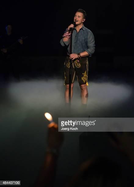 Singer Andreas Gabalier performs during the TVShow 'Gabalier Die VolksRock'n'RollShow' on August 30 2014 in Fuessen Germany