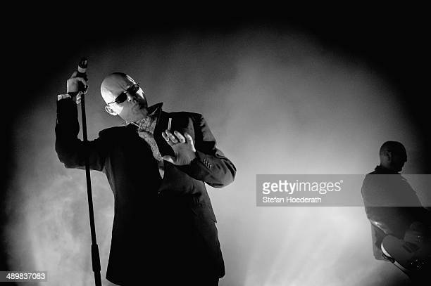 Singer Andrew Eldritch and guitarist Chris Catalyst of British group The Sisters Of Mercy perform live during a concert at Columbiahalle on May 12...