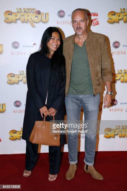 Singer Anggun and Christian Kretschmar attend the 'Le Petit Spirou' Paris Premiere at Le Grand Rex on September 10 2017 in Paris France