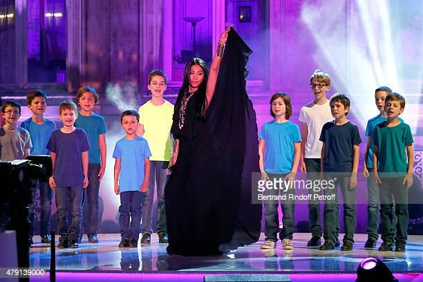 Singer Anggun performs during the 'Une Nuit avec la Police et la Gendarmerie' France 2 TV Show Held at Ministere de l'Interieur in Paris on June 30...