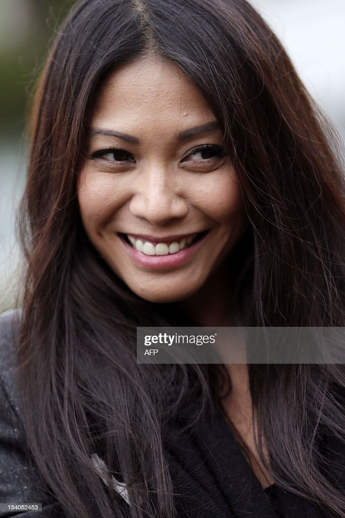 Singer Anggun poses during the 79th Montmartre vineyard's harvest on October 13, 2012 in Paris. The 'Vendanges' takes place every year in the heights of the hilly Montmartre neighborhood, in a small vineyard producing a modest 1,500 bottles of Pinot Noir and Gamay. The tiny plot, located at 14-18 rue des Saules (Metro Lamarck-Caulaincourt), reminds us of the area's once bucolic nature-- the village of Montmartre was formerly covered in vineyards.