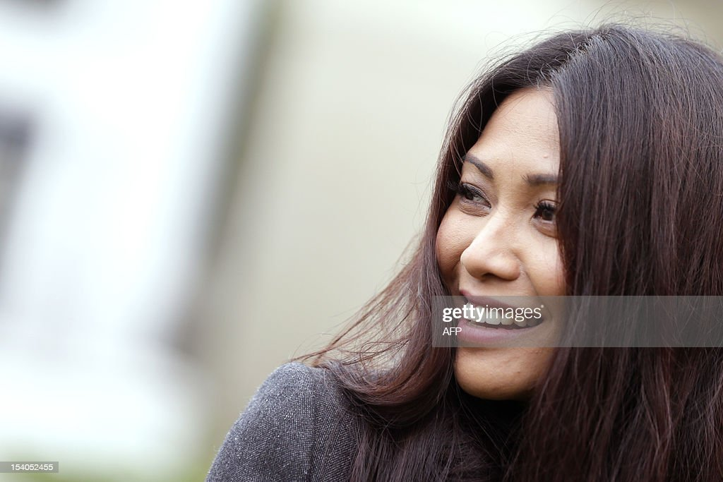 Singer Anggun poses during the 79th Montmartre vineyard's harvest on October 13, 2012 in Paris. The 'Vendanges' takes place every year in the heights of the hilly Montmartre neighborhood, in a small vineyard producing a modest 1,500 bottles of Pinot Noir and Gamay. The tiny plot, located at 14-18 rue des Saules (Metro Lamarck-Caulaincourt), reminds us of the area's once bucolic nature-- the village of Montmartre was formerly covered in vineyards. AFP PHOTO KENZO TRIBOUILLARD