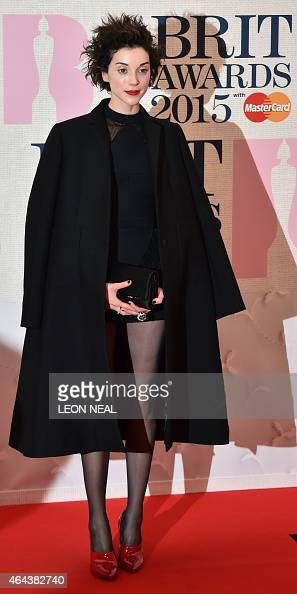US singer Annie Clark also known as St Vincent poses on the red carpet to attend the BRIT Awards 2015 in London on February 25 2015 AFP PHOTO / LEON...