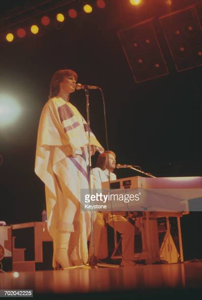 Singer AnniFrid Lyngstad and pianist Benny Andersson performing with Swedish pop group Abba on their third and final tour 1979