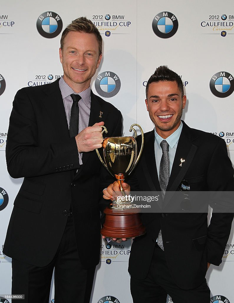Singer <a gi-track='captionPersonalityLinkClicked' href=/galleries/search?phrase=Anthony+Callea&family=editorial&specificpeople=207095 ng-click='$event.stopPropagation()'>Anthony Callea</a> (R) and Tim Campbell hold the Caulfield Cup as they attend Caulfield Cup Day at Caulfield Racecourse on October 20, 2012 in Melbourne, Australia.