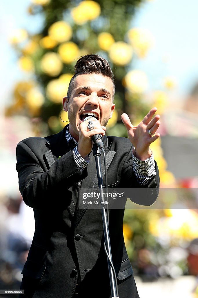 Singer <a gi-track='captionPersonalityLinkClicked' href=/galleries/search?phrase=Anthony+Callea&family=editorial&specificpeople=207095 ng-click='$event.stopPropagation()'>Anthony Callea</a> performers before the AAMI Victoria Derby on Victoria Derby Day at Flemington Racecourse on November 2, 2013 in Melbourne, Australia.