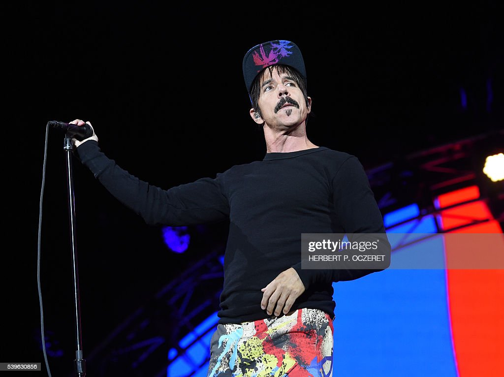 US singer Anthony Kiedis of rock band 'Red Hot Chili Peppers' performs during a concert at the 'Red Stage' under the 'Nova Rock 2016' Festival on June 12, 2016 in Nickelsdorf. / AFP / APA / HERBERT P. OCZERET / Austria OUT