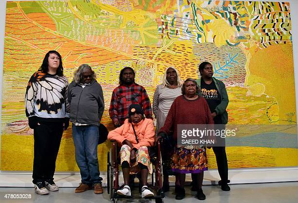 Singer Antony Hegarty poses with Aboriginal artists in front of the painting 'Kalyu' meaning water at Sydney's Museum of Contemporary Art on June 22...