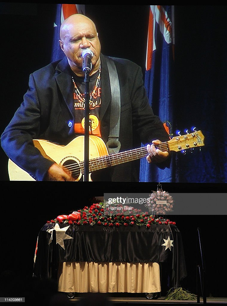 Singer Archie Roach performs during the State Funeral held for former Australian boxer Lionel Rose at Festival Hall on May 16, 2011 in Melbourne, Australia. Rose, who passed away on May 8, was the first indigenous Australian to win a boxing world title and was the 1968 Australian of the Year.