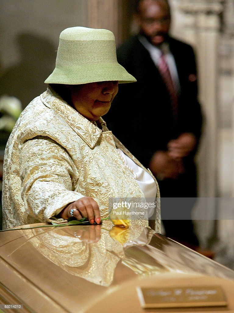 Singer Aretha Franklin lays a yellow rose on the casket of Luther Vandross during the funeral of Luther Vandross at Riverside Church July 8, 2005 in New York City.