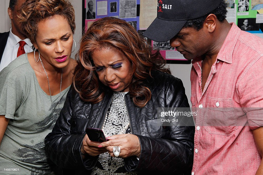 Singer Aretha Franklin (C) visits the cast backstage prior to attending a performance of 'A Streetcar Named Desire' at The Broadhurst Theatre on June 1, 2012 in New York City.