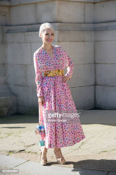 Singer Aria Crescendo wears a Manish Arora dress and bag and Yves Saint Laurent shoes on day 3 during Paris Fashion Week Autumn/Winter 2017/18 on...