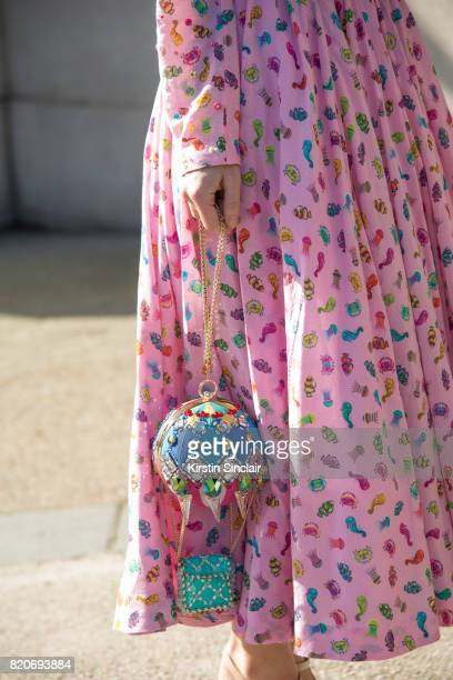 Singer Aria Crescendo wears a Manish Arora dress and bag on day 3 during Paris Fashion Week Autumn/Winter 2017/18 on March 2 2017 in Paris France