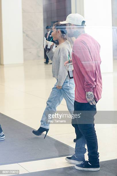 Singer Ariana Grande and rapper Mac Miller enter the Sirius XM Studios on September 20 2016 in New York City
