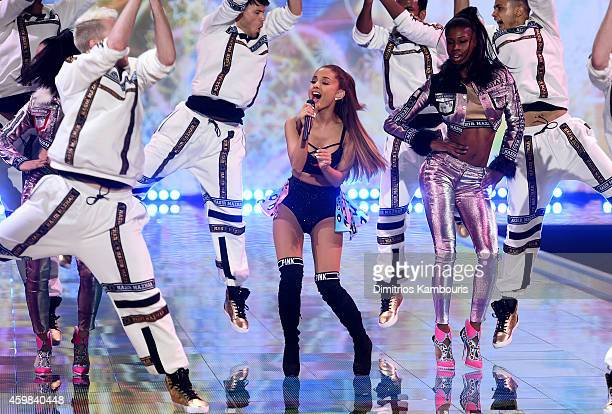 Singer Ariana Grande performs onstage during the 2014 Victoria's Secret Fashion Show at Earl's Court Exhibition Centre on December 2 2014 in London...