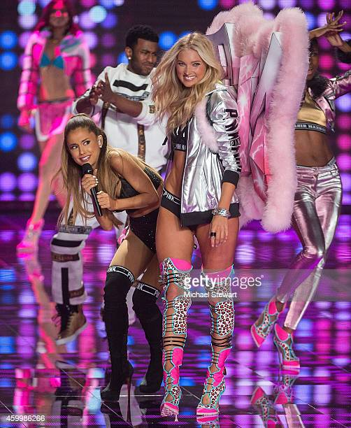 Singer Ariana Grande performs while model Elsa Hosk walks the runway at the annual Victoria's Secret fashion show at Earls Court on December 2 2014...