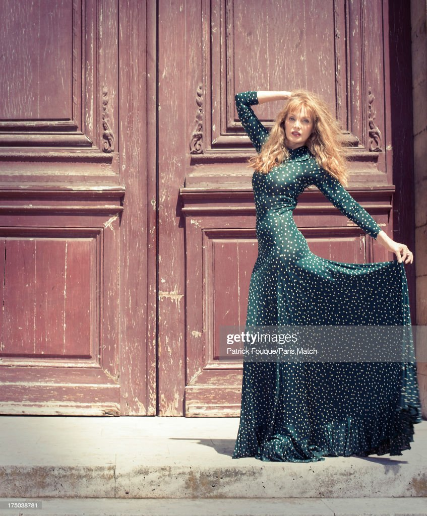 Singer <a gi-track='captionPersonalityLinkClicked' href=/galleries/search?phrase=Arielle+Dombasle&family=editorial&specificpeople=616903 ng-click='$event.stopPropagation()'>Arielle Dombasle</a> is photographed for Paris Match on July 9, 2013 in Paris, France.