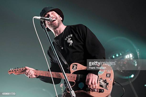 Singer Arnim TeutoburgWeiss of the German band Beatsteaks performs live during a concert at the MaxSchmelingHalle on November 27 2014 in Berlin...