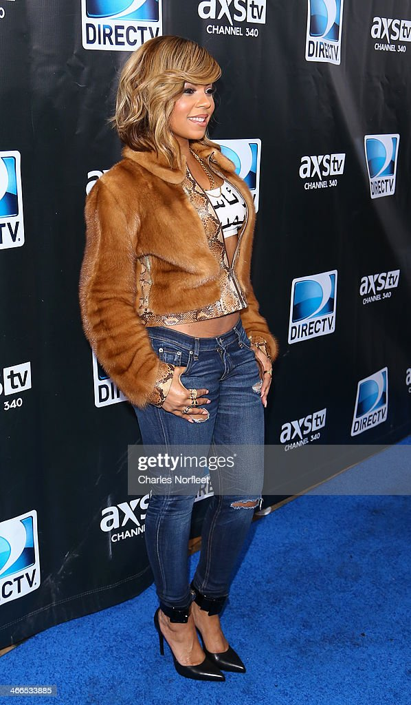 Singer <a gi-track='captionPersonalityLinkClicked' href=/galleries/search?phrase=Ashanti&family=editorial&specificpeople=146300 ng-click='$event.stopPropagation()'>Ashanti</a> attends the DirecTV Super Saturday Night at Pier 40 on February 1, 2014 in New York City.