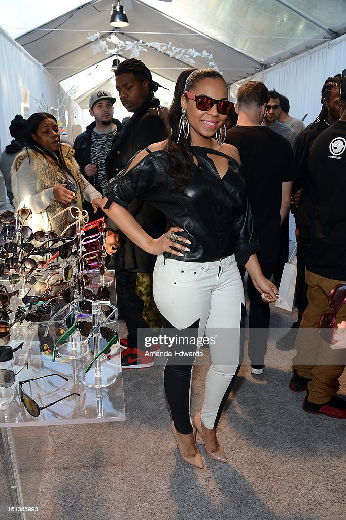 Singer <a gi-track='captionPersonalityLinkClicked' href=/galleries/search?phrase=Ashanti&family=editorial&specificpeople=146300 ng-click='$event.stopPropagation()'>Ashanti</a> in Carrera CA5002S poses with SOLSTICE Sunglasses and Safilo USA during the 55th Annual GRAMMY Awards at the STAPLES Center on February 9, 2013 in Los Angeles, California.