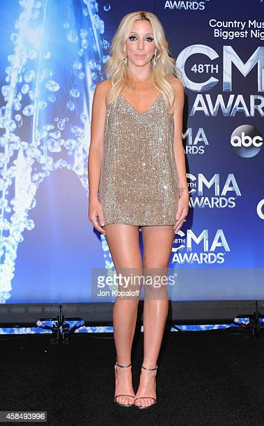 Singer Ashley Monroe poses in the press room at the 48th annual CMA Awards at the Bridgestone Arena on November 5 2014 in Nashville Tennessee