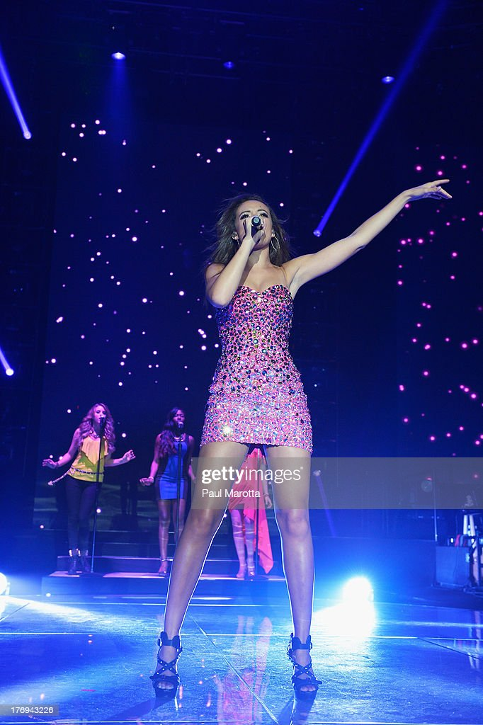 Singer <a gi-track='captionPersonalityLinkClicked' href=/galleries/search?phrase=Aubrey+Cleland&family=editorial&specificpeople=10563465 ng-click='$event.stopPropagation()'>Aubrey Cleland</a> performs during American Idol Live! 2013 at Agganis Arena at Boston University on August 19, 2013 in Boston, Massachusetts.