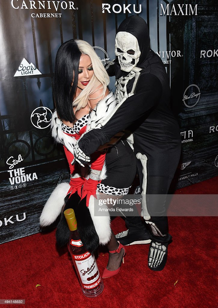 Singer Aubrey O'Day and actor Kyle Massey arrive at MAXIM Magazine's Official Halloween Party at a private estate on October 24 2015 in Beverly Hills...
