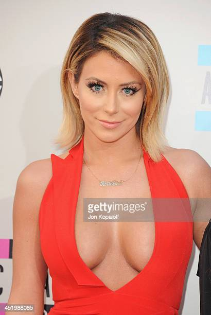 Singer Aubrey O'Day arrives at the 2013 American Music Awards at Nokia Theatre LA Live on November 24 2013 in Los Angeles California