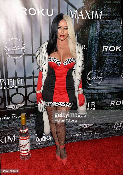 Singer Aubrey O'Day attends The Official MAXIM Halloween Party produced by Karma International on October 24 2015 in Beverly Hills California