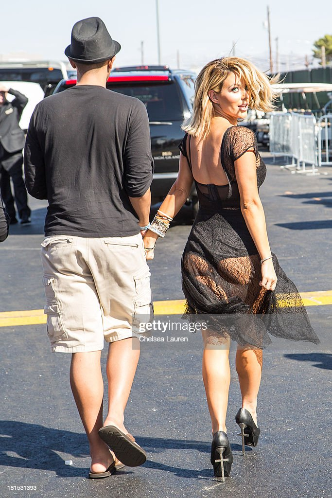 Singer <a gi-track='captionPersonalityLinkClicked' href=/galleries/search?phrase=Aubrey+O%27Day&family=editorial&specificpeople=570062 ng-click='$event.stopPropagation()'>Aubrey O'Day</a> of Danity Kane (R) backstage at The Village during the iHeartRadio music festival on September 21, 2013 in Las Vegas, Nevada.