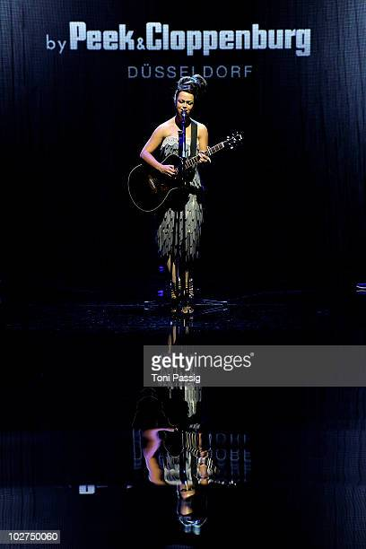 Singer Aura Dione performs during the Designer For Tomorrow Show during the Mercedes Benz Fashion Week Spring/Summer 2011 at Bebelplatz on July 9...