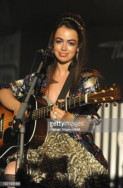 Singer Aura Dione performs during the Thomas Sabo parfum launch party at the Spiegelsalon on June 16 2010 in Munich Germany