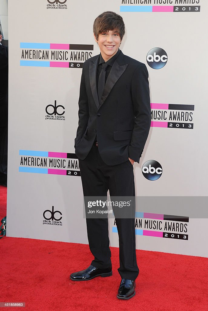 Singer Austin Mahone arrives at the 2013 American Music Awards at Nokia Theatre L.A. Live on November 24, 2013 in Los Angeles, California.
