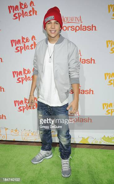 Singer Austin Mahone arrives at the Aquafina FlavorSplash Launch Party at Sony Pictures Studios on October 15 2013 in Culver City California