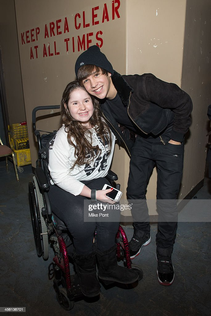 Singer Austin Mahone meets with a fan at the Z100 & Coca-Cola All Access Lounge at Hammerstein Ballroom on December 13, 2013 in New York City.
