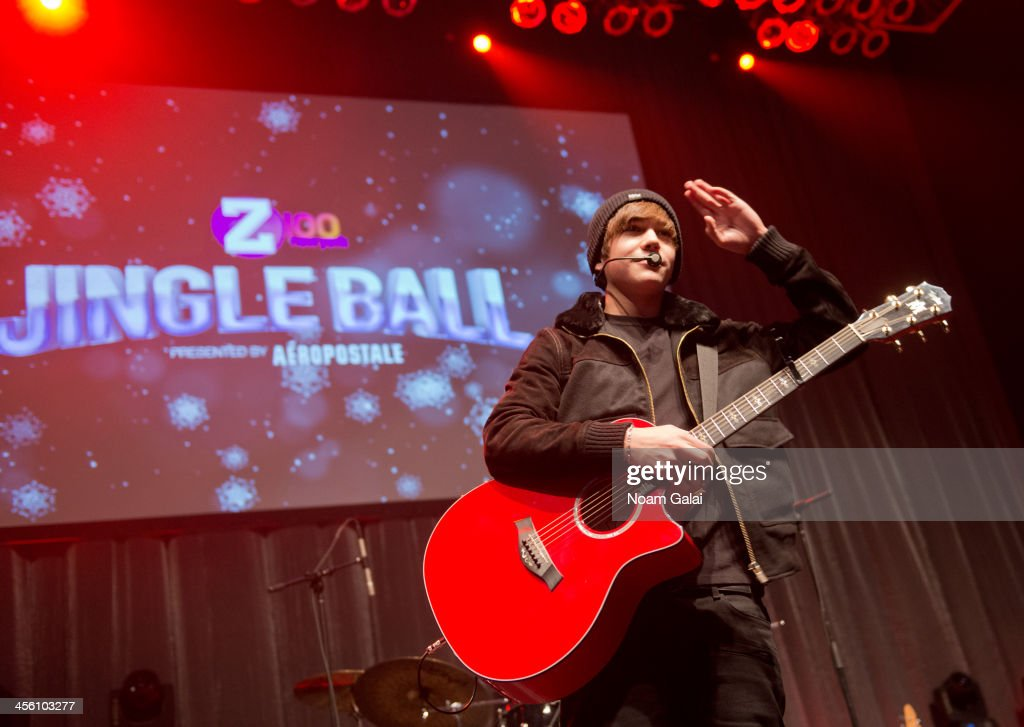 Singer <a gi-track='captionPersonalityLinkClicked' href=/galleries/search?phrase=Austin+Mahone&family=editorial&specificpeople=9429678 ng-click='$event.stopPropagation()'>Austin Mahone</a> performs at the Z100 & Coca-Cola All Access Lounge at Z100?s Jingle Ball 2013 pre-show at Hammerstein Ballroom on December 13, 2013 in New York City.