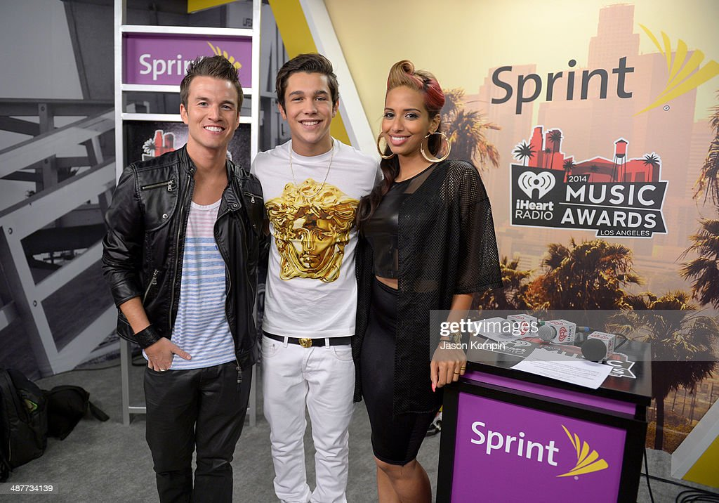 Singer Austin Mahone (C) poses with radio personalities Nathan Fast and Nessa backstage at the 2014 iHeartRadio Music Awards held at The Shrine Auditorium on May 1, 2014 in Los Angeles, California. iHeartRadio Music Awards are being broadcast live on NBC.