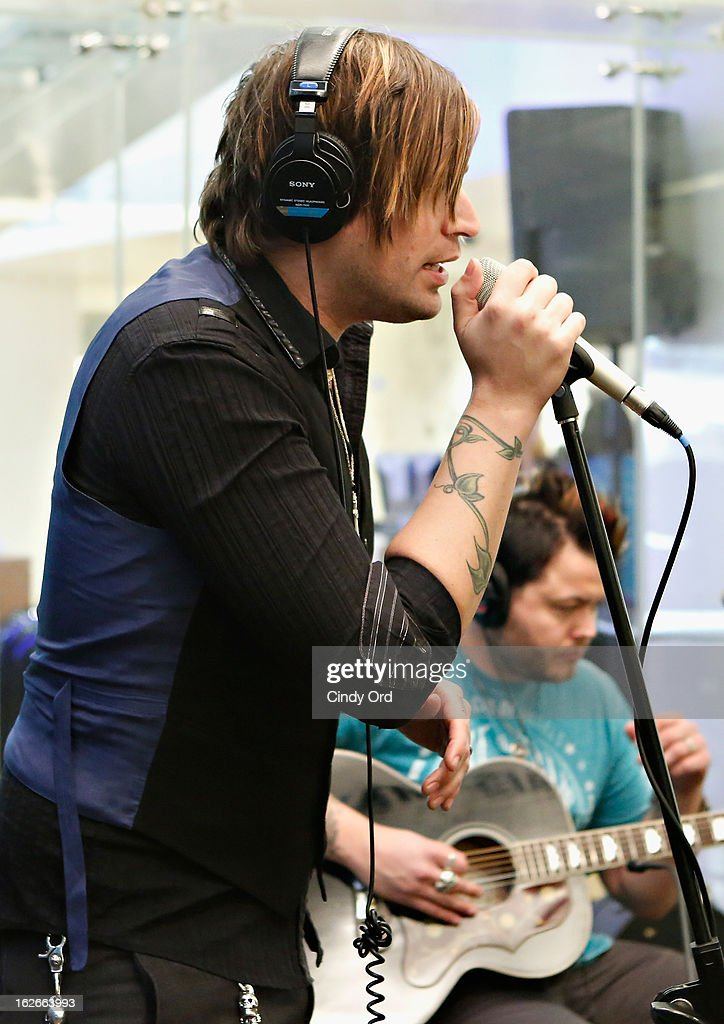 Singer <a gi-track='captionPersonalityLinkClicked' href=/galleries/search?phrase=Austin+Winkler+-+Singer&family=editorial&specificpeople=3968760 ng-click='$event.stopPropagation()'>Austin Winkler</a> of Hinder performs at the SiriusXM Studios on February 25, 2013 in New York City.