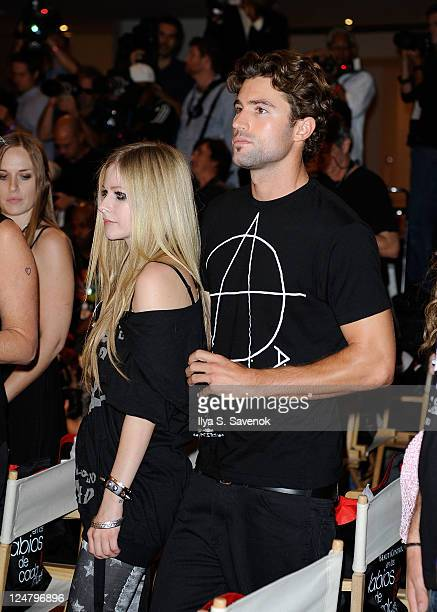 Singer Avril Lavigne and American television personality Brody Jenner attend the Abbey Dawn by Avril Lavigne Spring 2012 fashion show during Style360...