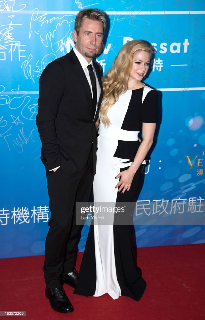 Singer Avril Lavigne and her husband Chad Kroeger pose on the red carpet during 2013 Huading Awards Ceremony at The Venetian on October 7 2013 in...