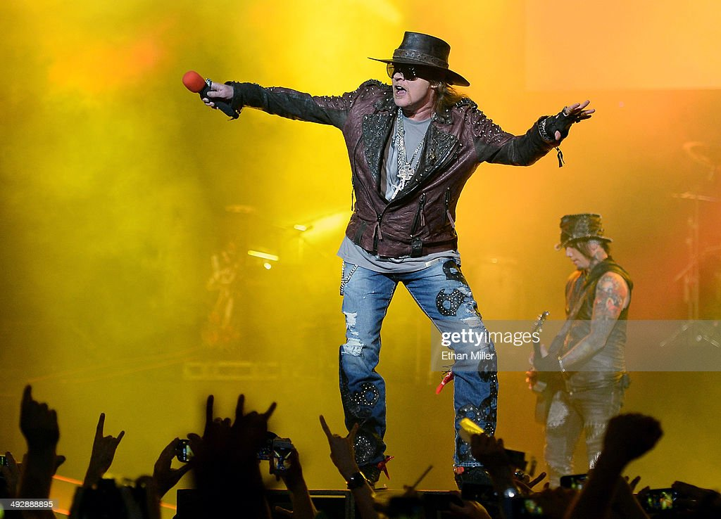 Singer Axl Rose (L) and guitarist Dj Ashba of Guns N' Roses perform at The Joint inside the Hard Rock Hotel & Casino during the opening night of the band's second residency, 'Guns N' Roses - An Evening of Destruction. No Trickery!' on May 21, 2014 in Las Vegas, Nevada.