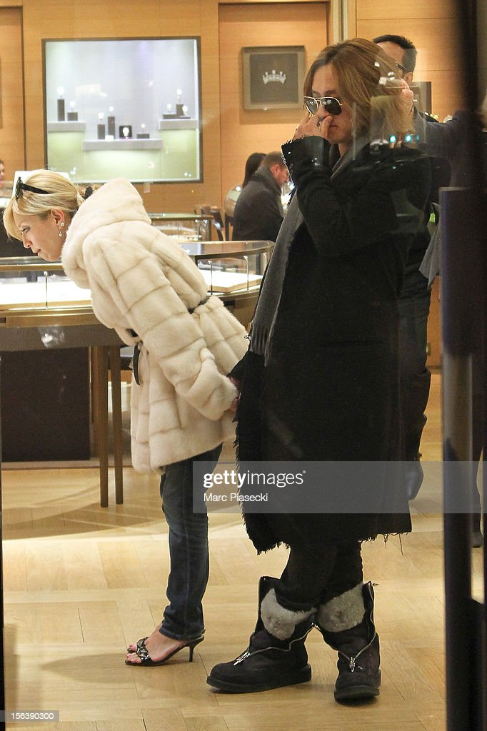 Singer <a gi-track='captionPersonalityLinkClicked' href=/galleries/search?phrase=Ayumi+Hamasaki&family=editorial&specificpeople=2371548 ng-click='$event.stopPropagation()'>Ayumi Hamasaki</a> and boyfriend Maro are seen at the 'Cartier' store in 'Rue du Faubourg Saint Honore' on November 14, 2012 in Paris, France.